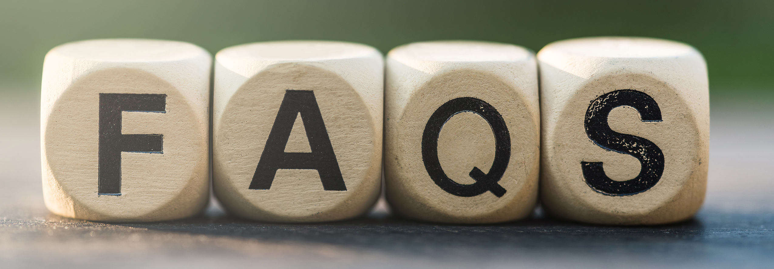 black-letters-on-wood-cubes-spelling-faqs_2550x866